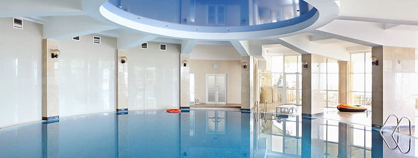 Serene swimming pool with stretch ceilings